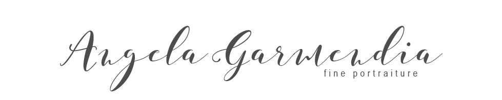 Photography by Angela Garmendia logo